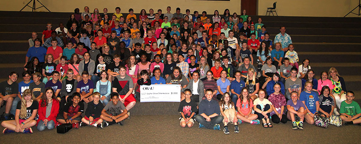 Students from Coulter Grove Intermediate School celebrate winning prize in Extreme Classroom Makeover Contest